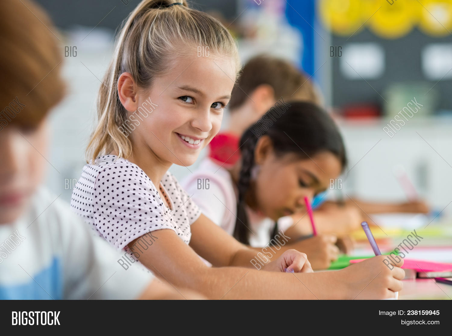 beautiful,boy,caucasian,cheerful,child,childhood,children,class,classmate,classroom,classwork,cute,desk,drawing,education,elementary,elementary students,exam,face,girl,happy,kid,kids,knowledge,learn,lesson,library,little,looking,looking at camera,people,portrait,pretty,primary,pupil,scholar,school,schoolchild,sitting,smile,student,study,studying,write,young