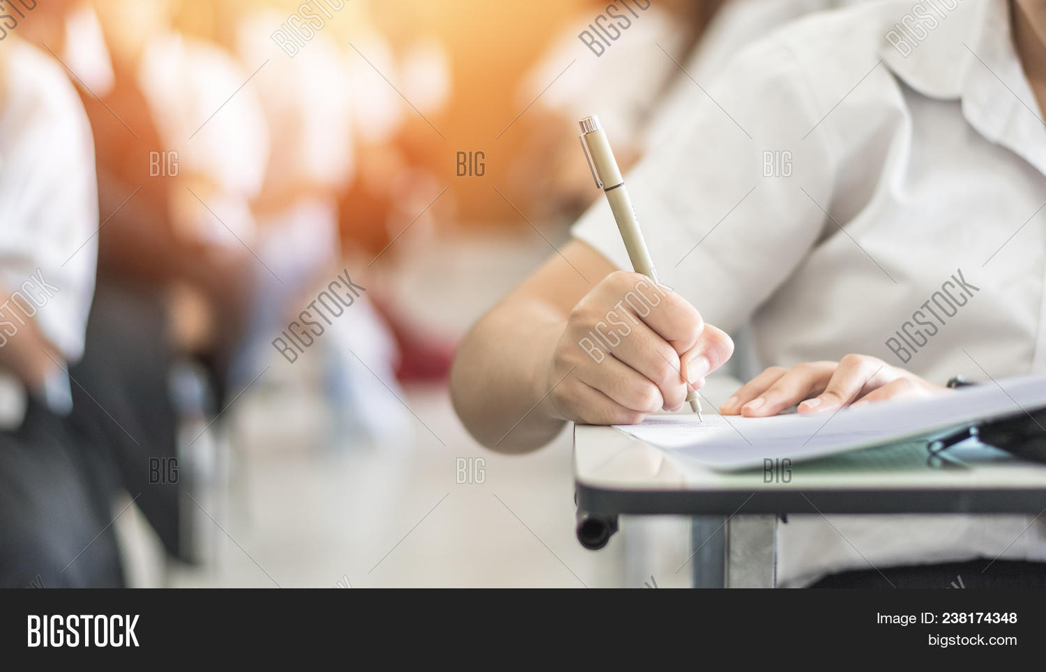 Exam With School Student Having A Educational Test, Thinking Hard, Writing Answer In Classroom For U