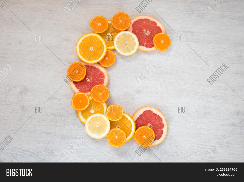 Vitamin C Symbol Made Of Sliced Orange Grapefruit Mandarin And