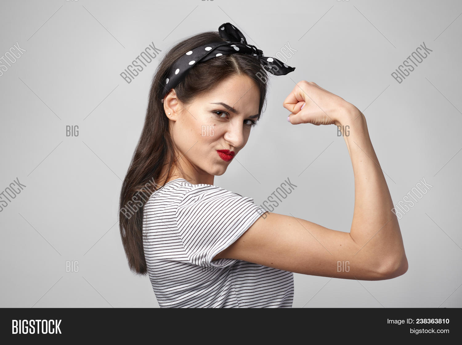 adult,arm,attitude,attractive,background,beautiful,beauty,bicep,body,brunette,casual,caucasian,confident,cute,emotion,expression,face,fashion,female,femininity,fighter,fist,fit,flexing,gesture,girl,hair,hand,happy,isolated,lady,looking,model,muscle,one,people,person,portrait,power,pretty,showing,smile,smiling,strength,strong,studio,white,woman,young