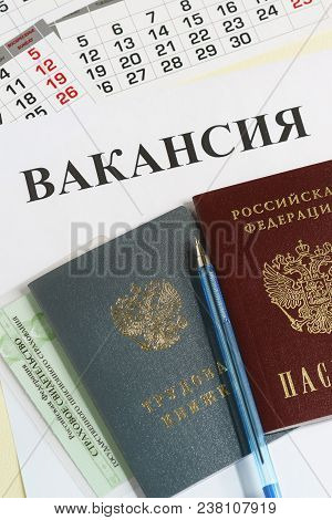 Russian documents for employment: employment record book and passport. The inscription in Russian - the questionnaire of the candidate for the position and Vacancy. Employment opportunity stock photo
