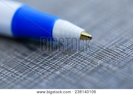 Closeup of a ballpoint pen, shallow depth of field with focus on top of pen. Ball point biro pen in macro photo key on fancy background. Close up focused on the top of pen ball. Best conceptual picture for bloggers and social media covers. stock photo