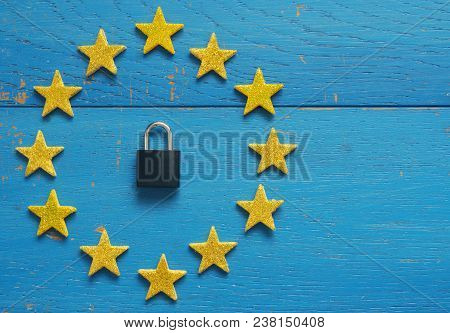 European Union sign with a padlock on a blue rustic wooden background, DSGVO concept image stock photo