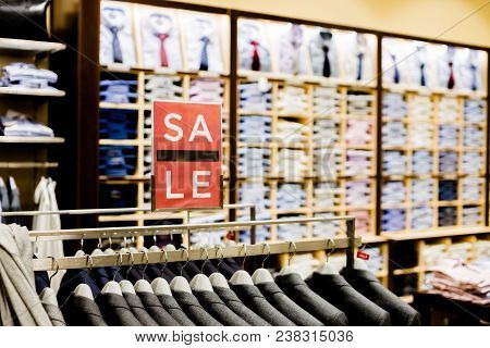 Sale sign in men clothes shop.shopping and discount concept. Retail Image Of A Final Sale Sign In A Clothing Store stock photo