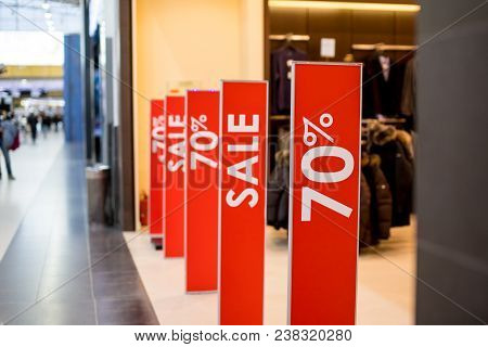 Retail Image Of A Sale Sign In A Clothing Store Window stock photo