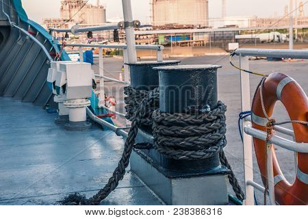 mooring equipment of ship. Mooring lines are fast on bollards, vessel is secured properly. All gears are in good order. Marine sea job. Port on background stock photo