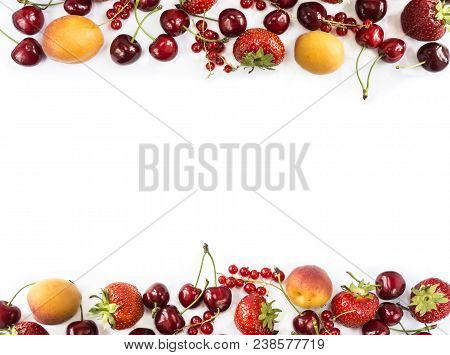 Mix berries isolated on a white. Ripe apricots, red currants, cherries and strawberries. Berries and fruits with copy space for text. Various fresh summer berries on white background. Background berries. Top view. stock photo