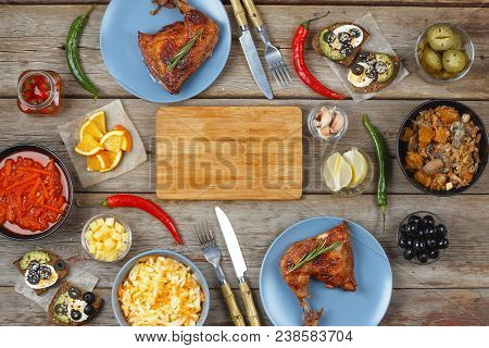 Supper table. Various dishes and snacks for two people. Date. Dinner outside the house. Fried chicken and salad. stock photo