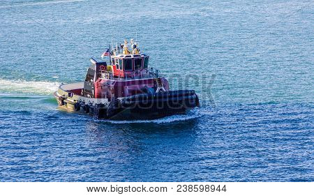 A Red and Black Tugboat in Biscayne Bay stock photo