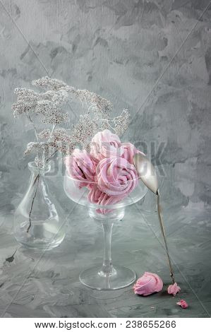 Delicate marshmallow handmade in a glass vase in still life. Close up. stock photo