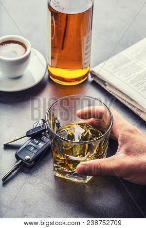 Car keys and glass of alcohol on table in pub or restaurant. stock photo