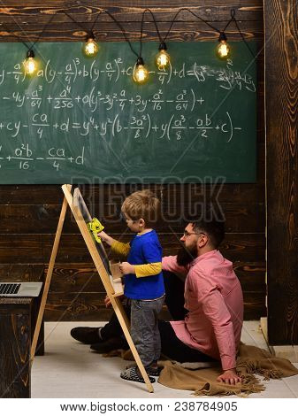Professor And School Student At The Classroom In A School. Conference Training. Final Exam Test In U