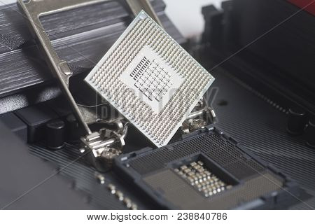 Intel LGA 1151 cpu socket on motherboard Computer PC with cpu processor close up stock photo