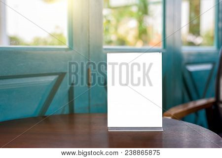 Table tent for blank menu frame on wooden table in bar restaurant cafe. stock photo