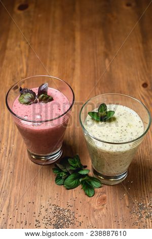 fruit smoothie with chia seeds. Smoothies with a banana, mint, strawberry, raspberry and kiwi. Close-up stock photo