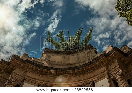 Bronze statue adorning the Grand Palais building top in a sunny day at Paris. Known as the