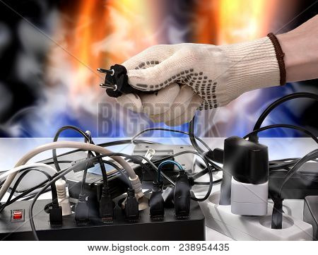 Fire electric cables from the mains voltage overload. Conceptual meaning of negligence in the use of electrical networks stock photo