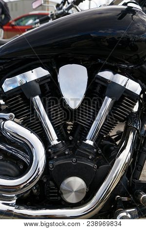 Closeup photo of V-type 2-cylinder vee twin engine and exhaust pipes of the motorcycle stock photo
