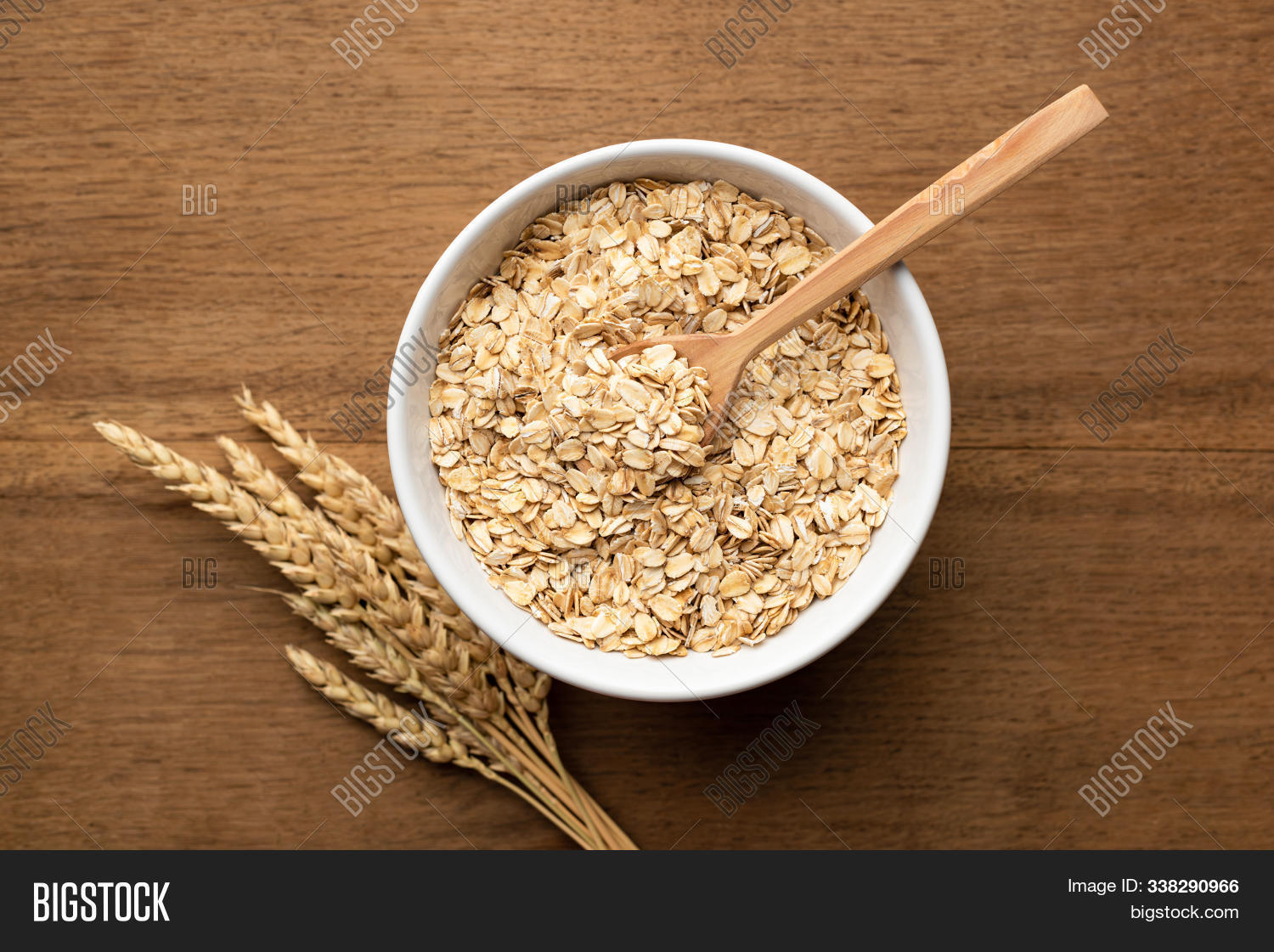 agriculture,background,bowl,breakfast,brown,cereal,close,closeup,cuisine,culture,detail,diet,dry,fiber,flake,food,golden,grain,groat,health,healthy,heap,ingredient,isolated,kernel,meal,natural,nobody,nutrition,oat,oatmeal,plant,porcelain,porridge,portion,raw,ripe,rolled,seed,snack,spill,stem,summer,texture,uncooked,white,whole,wooden