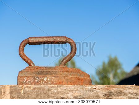 Vintage Old rusty iron for ironing. Antique household item on sunny day stock photo