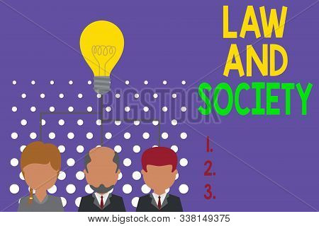 Writing note showing Law And Society. Business photo showcasing Address the mutual relationship between law and society Group three executive persons sharing idea icon. Startup team meeting. stock photo