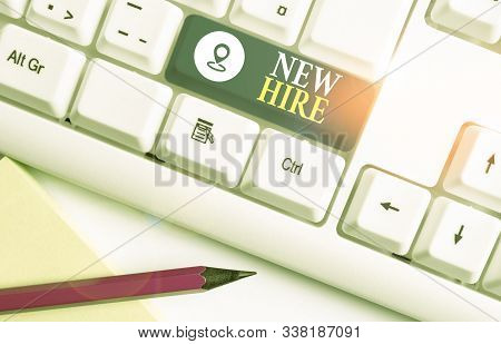Word writing text New Hire. Business concept for someone who has not previously been employed by the organization White pc keyboard with empty note paper above white background key copy space. stock photo