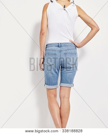 Printed Women's Light blue Basic Shorts, blue distressed denim skirt, Mid Wash Ripped Denim High Shorts for Women, Bombshell High Waist Cutoff Denim Shorts, High Waist Acid Wash Ripped Distressed Shorts.. stock photo