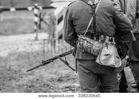 German soldier during the second world war in uniform with a rifle and bayonet with a knife. Black and white photography stock photo