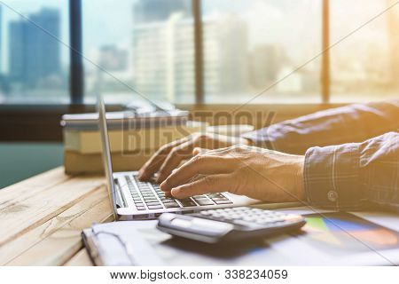 Office desk table of modern workplace with laptop on wooden table, top view laptop background and copy space on wooden background, White desk office with laptop, smartphone and other work supplies on wood desk, laptop background stock photo