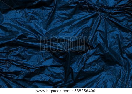 Classic blue crumpled metallic texture synthetic background. Abstract pattern for design. Trend of 2020 color stock photo