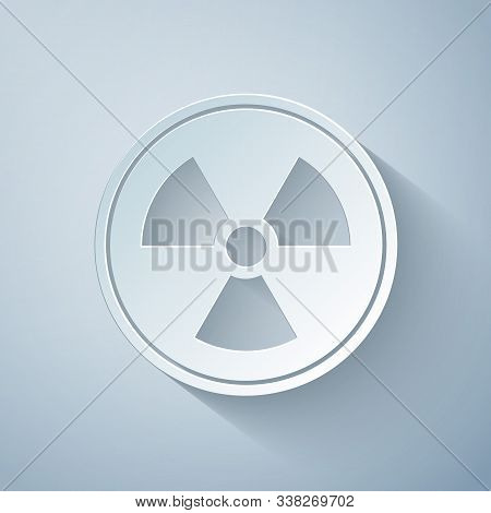 Paper cut Radioactive icon isolated on grey background. Radioactive toxic symbol. Radiation Hazard sign. Paper art style. Vector Illustration stock photo