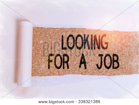 Conceptual hand writing showing Looking For A Job. Business photo showcasing Unemployed seeking work Recruitment Huanalysis Resources Cardboard which is torn placed above a wooden classic table. stock photo