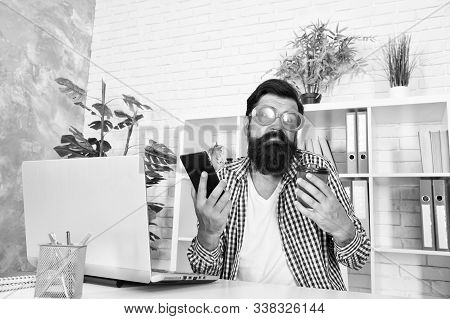 I dont know. Funky man with shrug face holding mobile phone and coffee cup at work. Brutal hipster using his cell phone. Placing order by phone. Video conferencing is as easy as making a phone call. stock photo