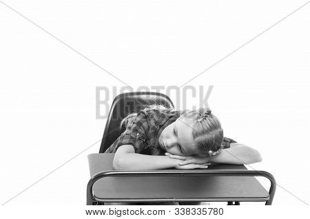 Boring topic. Bored pupils riot. Fall asleep on lesson. Girl sleep school lesson white background. Schoolgirl tired of studying. Kid sleepy face lean on desk and sleep. Tired pupil drowsy face sleep. stock photo