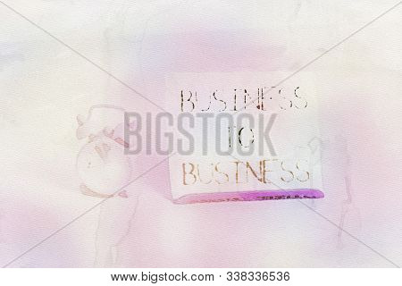 Conceptual hand writing showing Business To Business. Business photo text Commercial Transaction between two Businesses Alarm clock beside a Paper sheet placed on pastel backdrop. stock photo