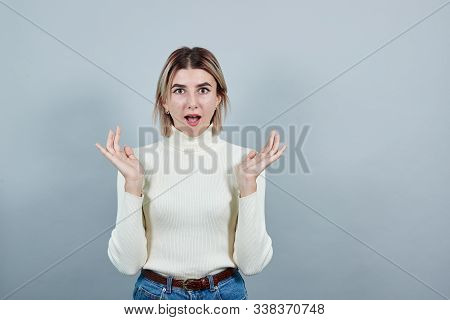 Young beautiful caucasian lady over white background in studio looking irritated and angry expressing negative emotion, annoyed with someone. stock photo
