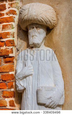 Moorish merchant with turban ancient medieval statue located in Campo dei Mori (Moors Square) in the historic center of Venice (13th century, author unknown) stock photo