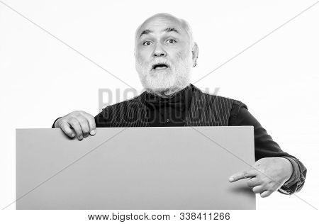 surprised mature man in formal suit. Advertisement. Senior bearded man place announcement on banner. job search. Need help. wanted. Copy space information. Advertisement shop. Your advertising here stock photo