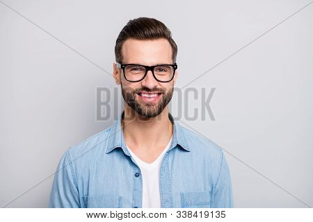 Closeup photo of amazing friendly business guy perfect neat appearance hairstyle young promoted boss chief wear specs casual denim outfit isolated grey color background stock photo