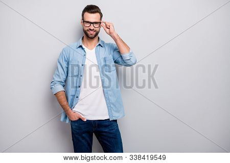Photo of attractive macho guy perfect appearance neat hairstyle bristle young promoted boss chief easy-going person wear casual denim outfit isolated grey color background stock photo