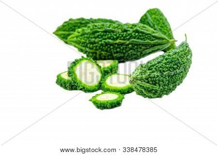Bitter gourd pile and piece on white background. vegetable herb Nourish the health body stock photo
