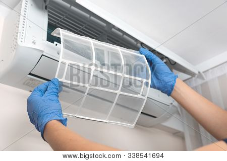 Modern air conditioner unit service. Cleaning the filter, fumigation. Air conditioner service. stock photo