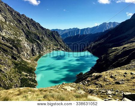 Beautiful view of blue alpine lake high in mountains with turquoise water stock photo