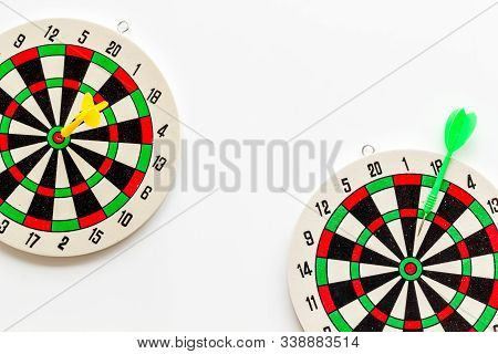 Goal achievement concept. Dartboard and arrows or dart on white background top view copy space stock photo