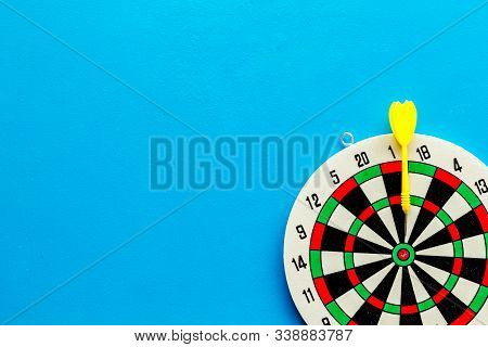 Goal achievement concept. Dartboard and arrows or dart on blue background top view copy space stock photo