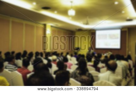 People in meeting or conference room blurred for background. stock photo