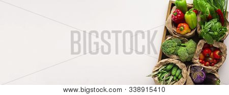 Sustainable lifestyle concept. Assortment of fresh organic vegetables for vegetarian diet isolated on white background, panorama, copy space stock photo