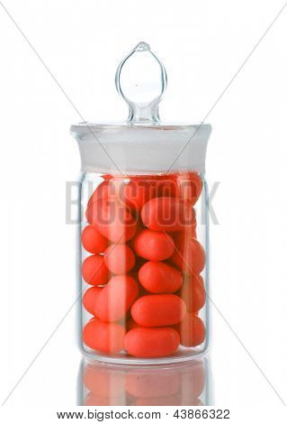 Transparent bottle with pills isolated on white stock photo