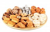 Sweet treats on wooden plate confined on white