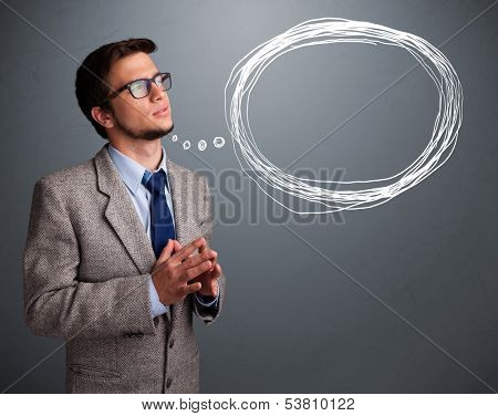 Good-looking young man thinking about speech or thought bubble with copy space stock photo